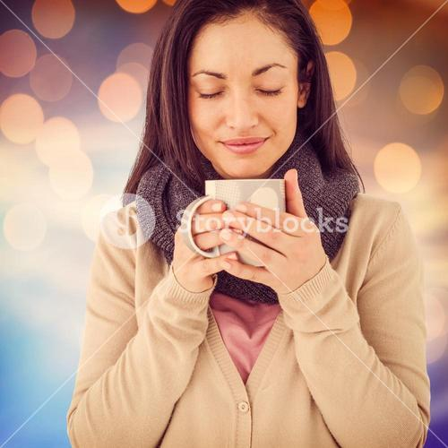 Composite image of smiling woman smelling hot beverage