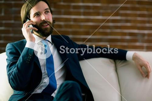 Businessman talking on the couch