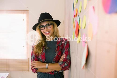 Pretty designer thinking and smiling