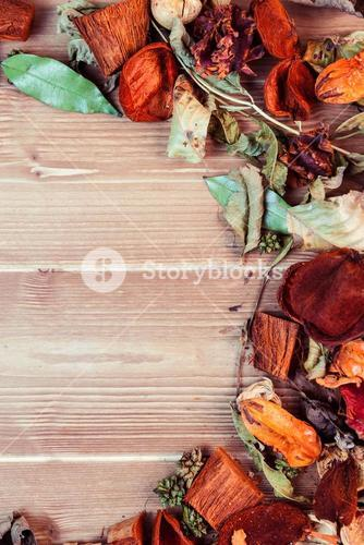 Overhead of autumn leaves on desk