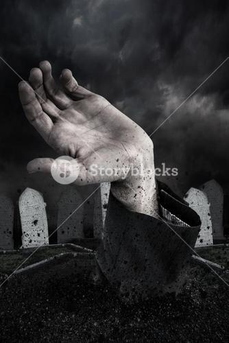 Zombie hand bursting from the grave