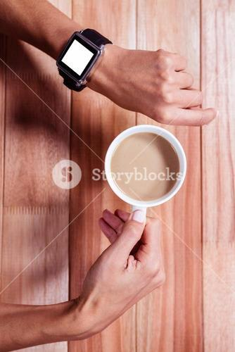 Feminine hands with smart control and coffee