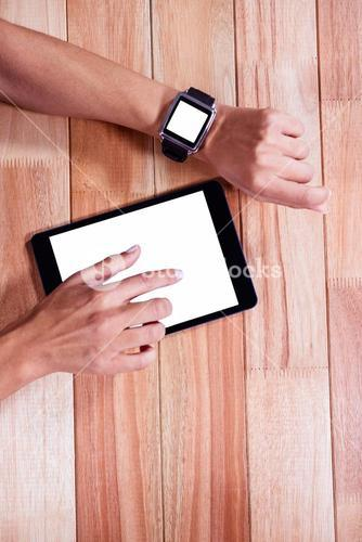Feminine hands with smartwatch using tablet