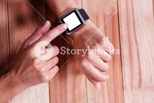 Part of hands typing on a watch