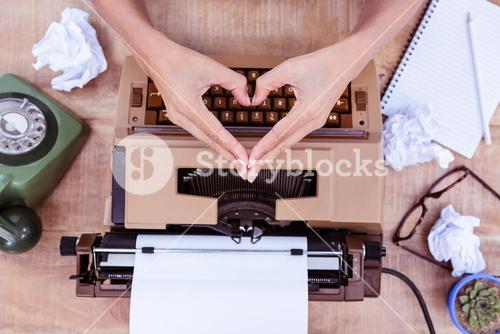Above view of typewriter and old phone