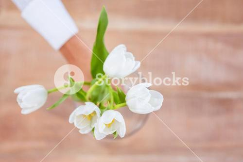 Woman putting a flowers in a vase