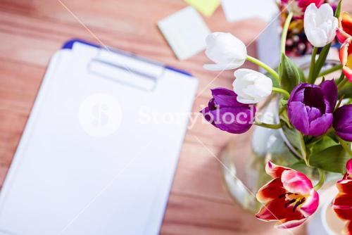 Bouquet of flower in a vase on the desk