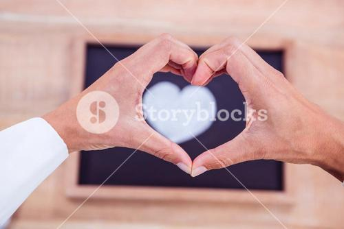View of hands making heart shape