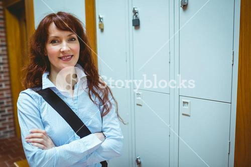 Mature student smiling in hallway