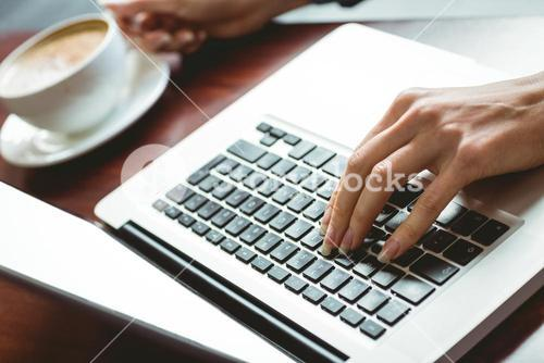 Student using laptop in cafe