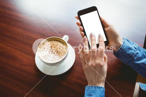 Woman taking a photo of her coffee