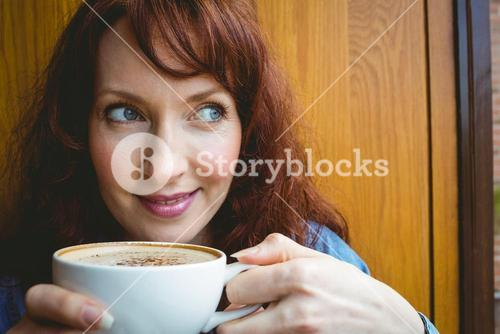 Mature student having coffee in cafe