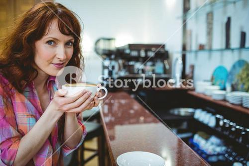 Mature student smiling in cafe