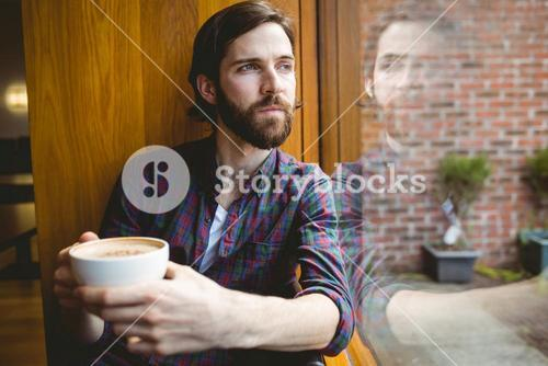 Hipster student having coffee in canteen
