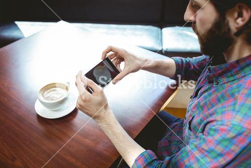Hipster student taking photo of coffee
