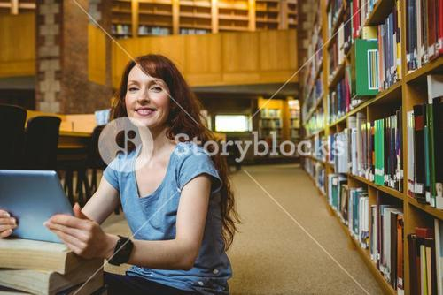 Mature student smiling in library
