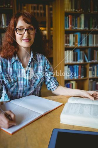 Mature student studying in library