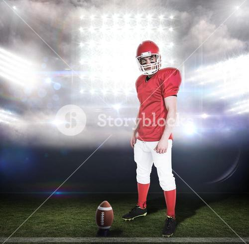 Composite image of serious american football player wearing a helmet