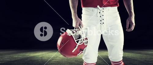 Composite image of american football player holding football