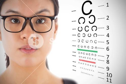 Composite image of businesswoman wearing glasses