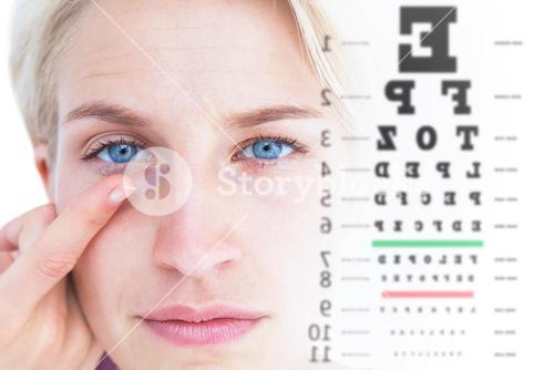 Composite image of pretty blonde applying contact lens