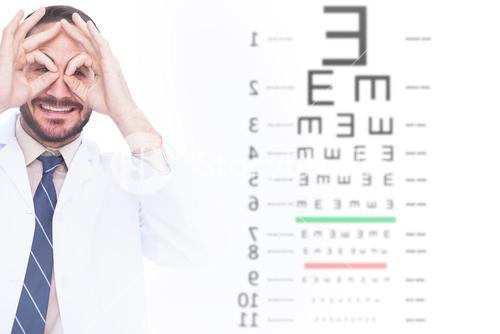 Composite image of smiling doctor forming eyeglasses with his hands