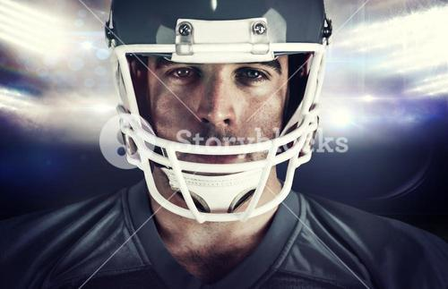 Composite image of american football player looking at camera