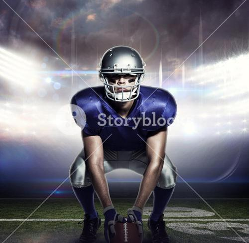Composite image of american football player with ball crouching