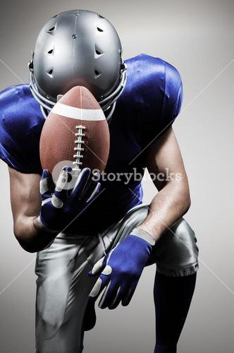 Composite image of upset american football player kneeling while holding ball