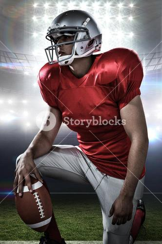 Composite image of sportsman holding american football while kneeling