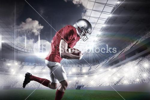 Composite image of american football player holding ball while running