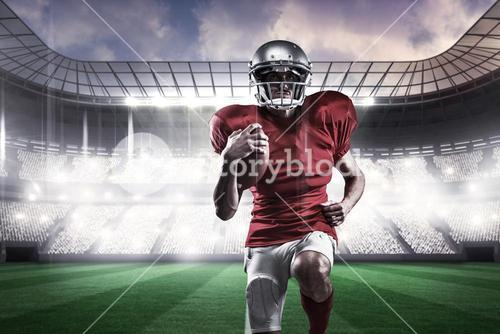 Composite image of full length of american football player in red jersey running