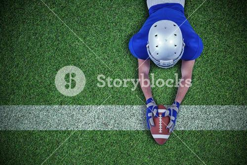 Composite image of rear view of american football player reaching towards ball