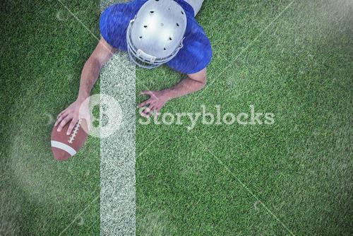 Composite image of rear view of american football player lying in front with ball