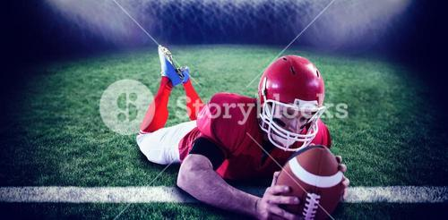 Composite image of american football player reaching football
