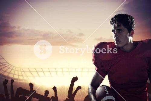 Composite image of serious american football player looking away holding ball