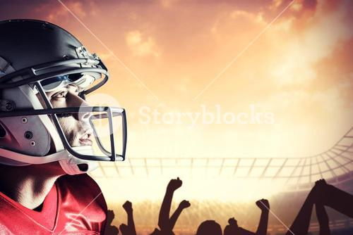 Composite image of american footballer looking up