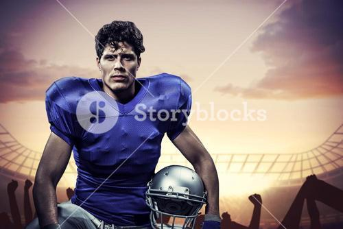 Composite image of portrait of serious sportsman with hand on knee holding helmet