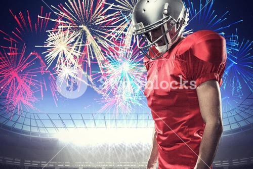 Composite image of american football player in red jersey looking down