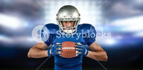 Composite image of portrait of confident sports player holding ball