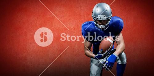 Composite image of american football player holding ball while kneeling
