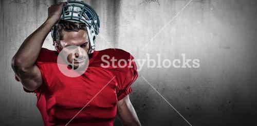 Composite image of american football player in removing helmet
