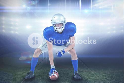 Composite image of alert american football player in attack stance