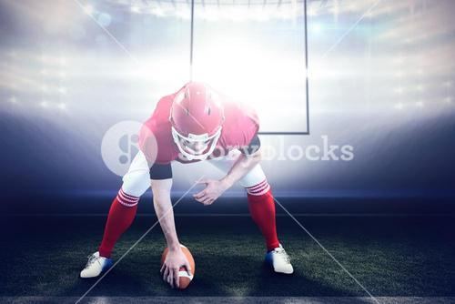 Composite image of american football player starting football game