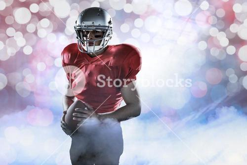 Composite image of portrait of determined sportsman with american football