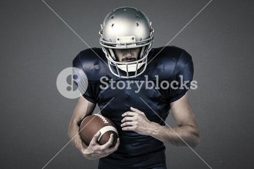 Composite image of sports player wearing helmet while holding ball