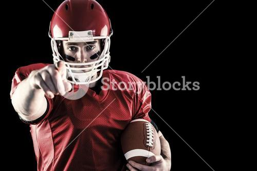 Composite image of portrait of american football player holding football and pointing to camera