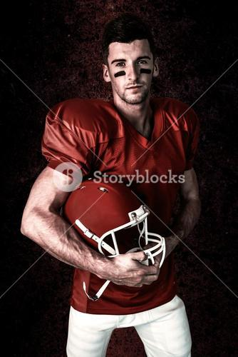 Composite image of portrait of rugby player posing with helmet