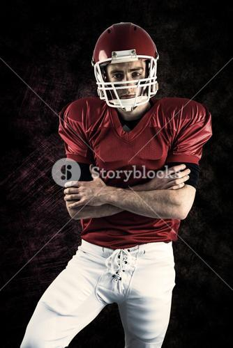 Composite image of portrait of serious american football player with arms crossed