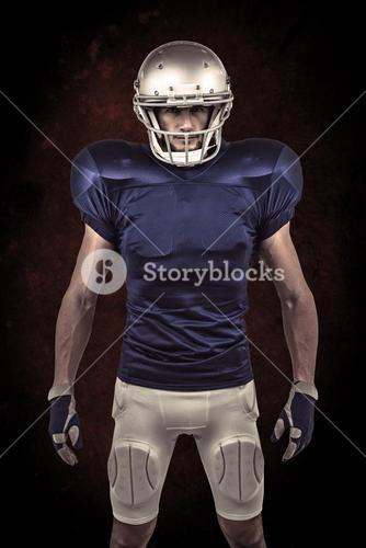 Composite image of serious american football player standing
